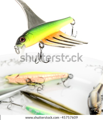Fork with artificial fishing bait, hard contrast, macro shot - stock photo