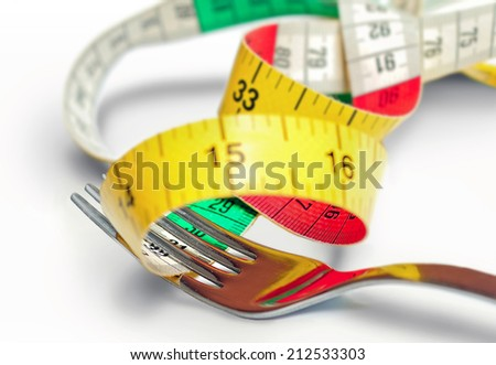 Fork with centimeter on white - stock photo