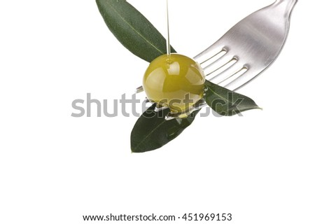 fork with olive and leaves with drop oil  - stock photo