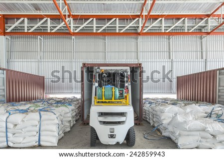 Forklift at the large modern warehouse - stock photo