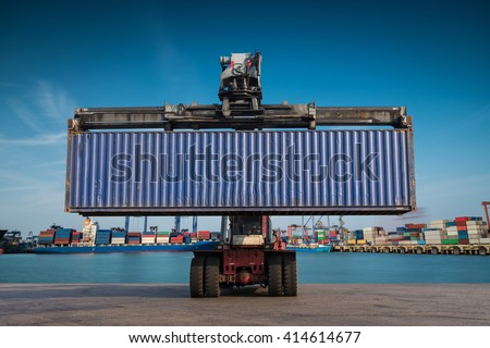 Forklift handling container box loading at port cargo at sunset - stock photo