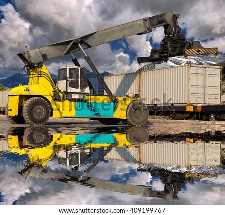 Forklift handling container box loading at the railroad yard - stock photo