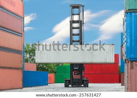 Forklift handling container box loading to depot - stock photo