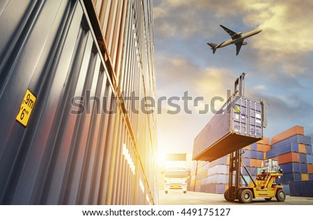 Forklift handling container box loading to freight trainer - stock photo