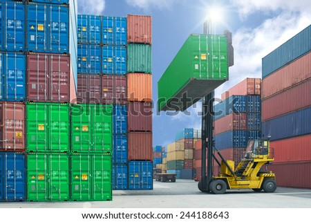 forklift handling container box loading to truck in import export logistic zone - stock photo