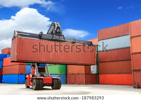 Forklift handling containers box at work on harbor for shipment  - stock photo