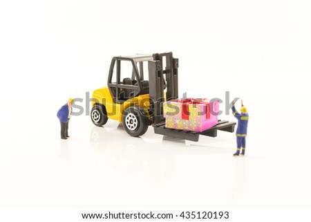 forklift in warehouse loading pink gift box,transportation business gift in special day concept - stock photo