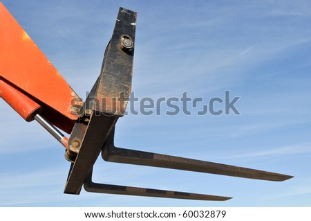 Forklift Lifter Close Up with Blue Sky - stock photo
