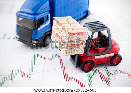 Forklift truck toys with boxes. Concept of international freight transport on business background - stock photo