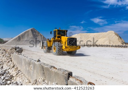 forklift - warehouse production in quarry blue clay on sky background - stock photo