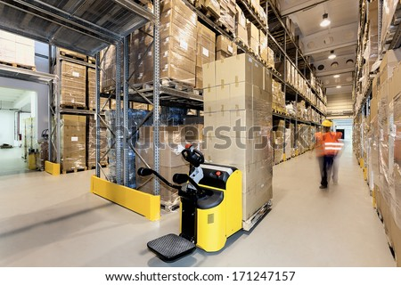 Forklift with products in a warehouse - stock photo