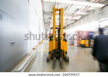 Forklift working at warehouse - stock photo