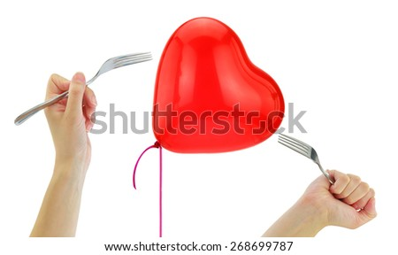 Forks about to pop a heart balloon isolated on white - stock photo