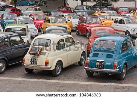 "FORLI' ITALY - JUNE 10: old italian small cars at ""Emozioni in 500"", rally of vintage economy car Fiat 500 on June 10, 2012 in Forli' Italy - stock photo"
