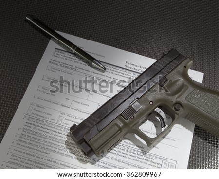 Form to check the background of a gun purchaser and handgun - stock photo