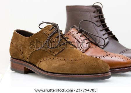formal brown wingtip leather and suede derby shoes - stock photo