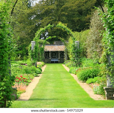 formal garden with arches - stock photo