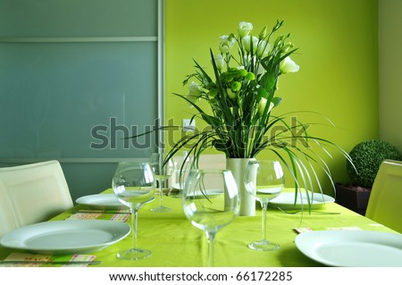 Formal table setting in a modern dining room - stock photo