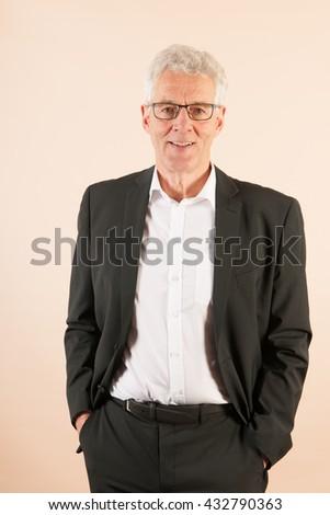 Formally dressed Senior business man  - stock photo