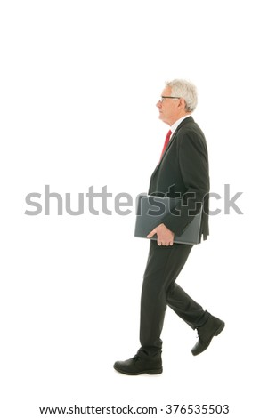 Formally dressed Senior business man with laptop - stock photo