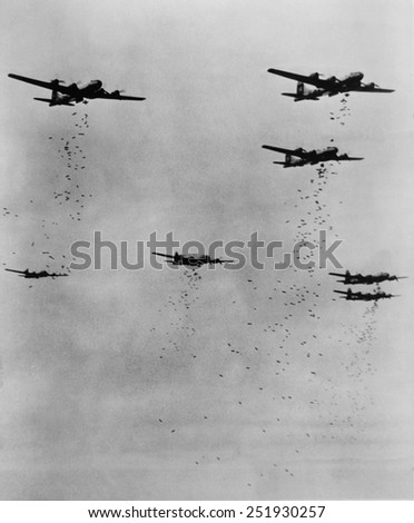 Formation of B-29's releasing incendiary bombs over Japan in June 1945. World War 2. - stock photo