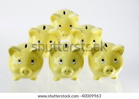 Formation of piggy banks isolated on white background - stock photo