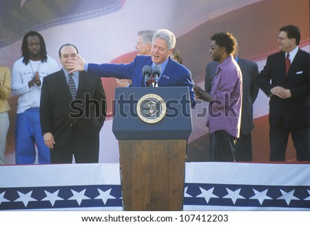 Former President Bill Clinton speaks at a Presidential rally for Gore/Lieberman on November 2nd of 2000 in Baldwin Hills, California - stock photo