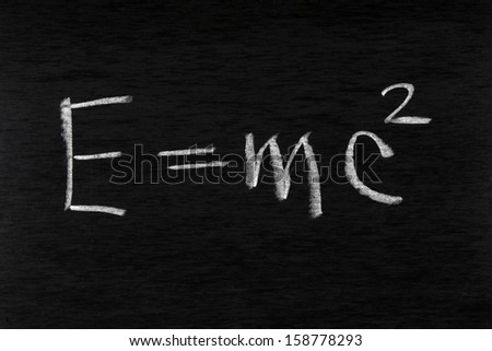 Formula of the law of conservation of energy written by chalk on a blackboard - stock photo