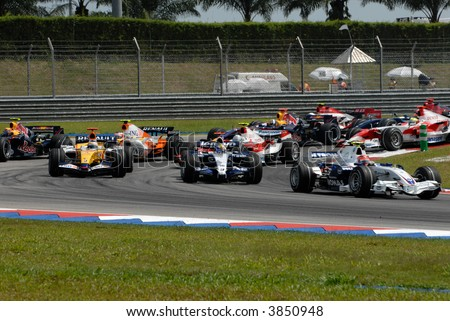 Formula One cars racing at F1 PETRONAS Grand Prix Sepang Malaysia 2007 - stock photo