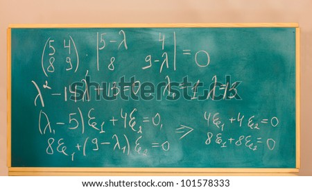 formulas written on green chalkboard - stock photo