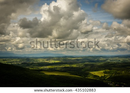 Forrest in the mountains and couds - stock photo