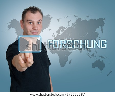 Forschung - german word for research - young man press button on interface in front of him - stock photo