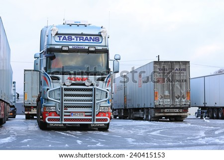 FORSSA, FINLAND - DECEMBER 20, 2014: Fleet of Scania trucks on an icy yard. Demand for heavy trucks is increasing while the need for medium-duty haulage is decreasing. - stock photo