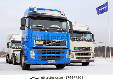 FORSSA, FINLAND - FEBRUARY 2, 2014: Used Volvo trucks on a yard. To improve road safety, Volvo Trucks have developed Driver Alert Support (DAS), which gives a signal when a driver is drifting off.  - stock photo