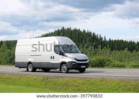FORSSA, FINLAND - JULY 25, 2015: New Iveco Daily Van on the road in South of Finland. The New Iveco Daily is the Van of the Year 2015. - stock photo