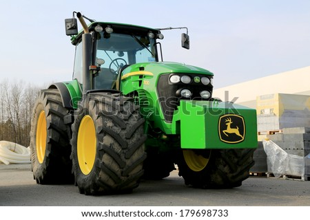 FORSSA, FINLAND - MARCH 1, 2014: John Deere 7830 Agricultural Tractor on display. Two John Deere innovations have won awards at the 2014 FIMA show held in Zaragoza, Spain in February. - stock photo