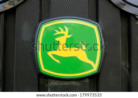 FORSSA, FINLAND - MARCH 1, 2014:  Sign John Deere on the front grille of  agricultural tractor. John Deere is awarded two silvers at Agritechnica 2013 in Hanover, Germany. - stock photo