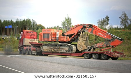 FORSSA, FINLAND - SEPTEMBER 19, 2015: Volvo FH16 hauls a Hitachi Zaxis 470 LCH Excavator. The  operating weight of 470LHC is 48,1 tonnes.  - stock photo