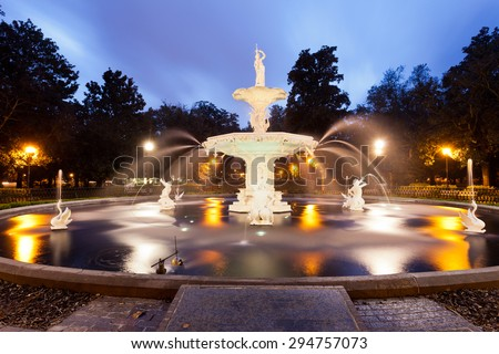 Forsyth Park Fountain famous landmark at night in Historic District of City of Savannah, Georgia, USA - stock photo