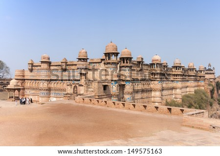 Fort and Palace of India's Gwalior is built on a cliff. Beige brown sandstones neatly decorated with blue tiles, - stock photo