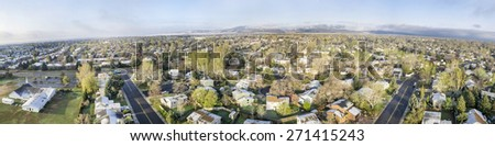 FORT COLLINS, CO, USA - APRIL 20 2015: Aerial panorama of Fort Collins, a typical residential neighborhood along Front Range of Rocky Mountains in Colorado,  early spring with some snow - stock photo