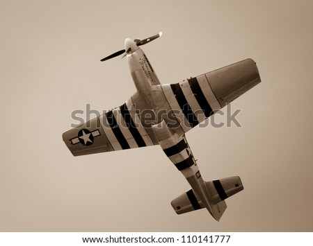 "FORT GEORGE, SCOTLAND - AUGUST 11: An unidentified pilot flies the P-51D Mustang plane ""Ferocious Frankie"" at the Celebration Of The Centuries event on August 11, 2012 at Fort George, Scotland. - stock photo"