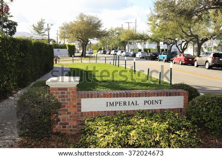 Fort Lauderdale, FL, USA - January 22, 2015: Brick Imperial Point neighborhood entrance sign on NE 62nd Street during the day. Imperial Point entrance sign - stock photo