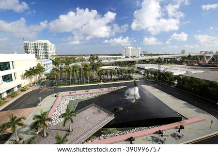 FORT LAUDERDALE,  FL, USA - March 11, 2016:  Aerial view of the 17th Street Causeway bridge, Port Everglades Marina,  the Broward County Convention Center and the Fort Lauderdale skyline.  - stock photo