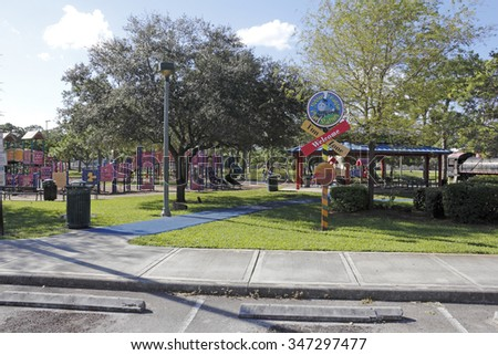 Fort Lauderdale, FL, USA - November 30, 2014: Large playground area of the Junior League Play Station Fun Zone. Families playing on the equipment at a Holiday Park playground. - stock photo
