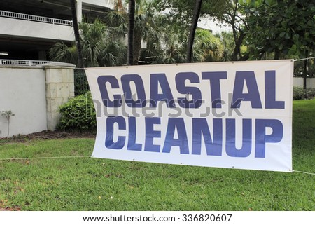 Fort Lauderdale, FL, USA - September 20, 2014: Coastal Cleanup sign with blue lettering and a white background. The sign is at the entrance to Earl Lifshey Ocean Park. - stock photo