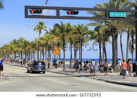 FORT LAUDERDALE, FLORIDA - FEBRUARY 3: Las Olas Boulevard has restaurants that serve food outdoors, shopping opportunities, art galleries, museums and more February 3, 2013 in Ft Lauderdale, Florida.  - stock photo