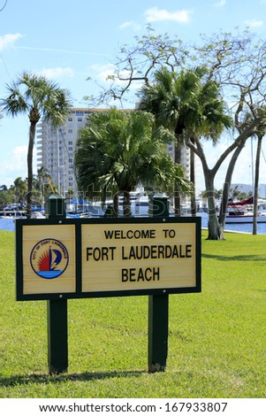 FORT LAUDERDALE, FLORIDA - FEBRUARY 3: Welcome to Fort Lauderdale Beach sign in Merle Fogg Idlewyld park near Las Olas Intracoastal waterway on a sunny February 3, 2013 in Ft Lauderdale, Florida.  - stock photo