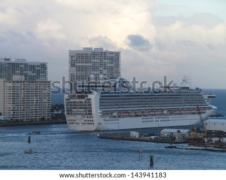 FORT LAUDERDALE, FLORIDA - NOVEMBER 18: Ruby Princess cruise ship sails away from Fort Lauderdale in Florida on November 18, 2012. It was built in 2008 and was officially named in Fort Lauderdale. - stock photo