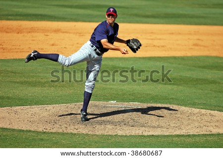 FORT LAUDERDALE - MARCH 9: Minnesota Twins relief pitcher Pat Neshek pitches in his first major league spring training season in Fort Lauderdale, FL March 9, 2006. - stock photo